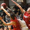 Webb City's Tevaris Young (2) and Grant Ellis (3) battle Neosho's Sam Cook for a rebound during their game on Tuesday night at Neosho.<br /> Globe | Laurie Sisk