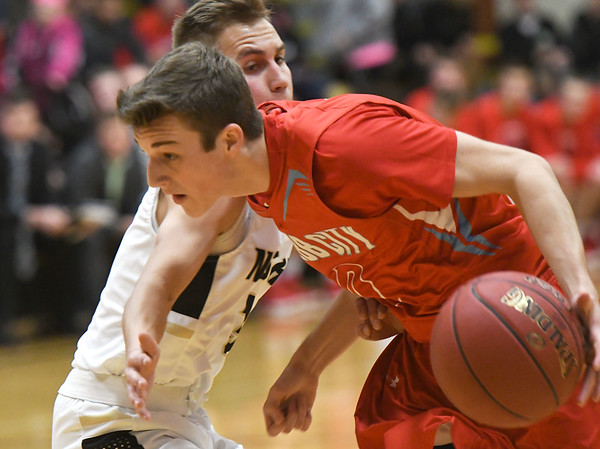 Webb City's Kyle Nichols (0) tries to get past Neosho's Cole Seward (3) during their game on Tuesday night at Neosho.<br /> Globe | Laurie Sisk