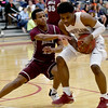Joplin's Evan Guillory tries to keep the ball from Rolla's Muluken Pritchett (11) during their game on Friday night at Kaminsky Gymnasium.<br /> Globe | Laurie Sisk
