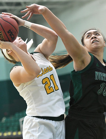 Missouri Southern's Desirea Buerge (21) puts up a shot as Northwest Missouri's Kaylani Maiava (35) defends during their game on Thursday night at MSSU.<br /> Globe | Laurie Sisk