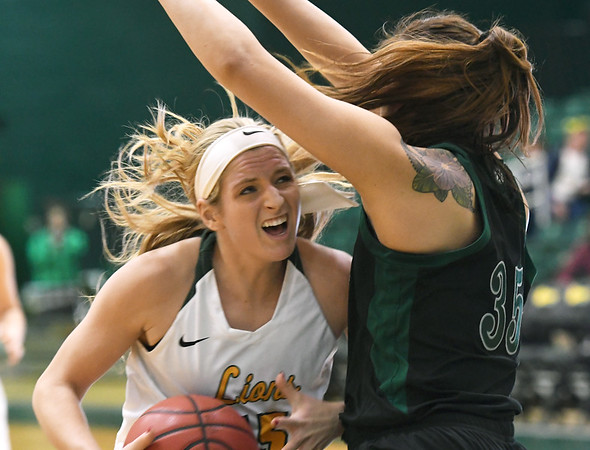 Missouri Southern's Chelsey Henry (15) tries to get past Northwest Missouri's Kaylani Maiava (35) during their game on Thursday night at MSSU.<br /> Globe | Laurie Sisk