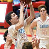 Webb City's Alex Pickett (11) gets by Carl Junction's Brendon Hoberecht, left, and Will BeBee for a score during their game on Tuesay night at Webb City.<br /> Globe | Laurie Sisk