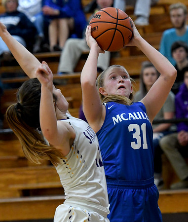 McAuley's Claire Lowry (31) puts up a shot as Sarcoxie's Kierston Dodson defends during the championship game of the Sarcoxie Girls Tournament on Saturday at Sarcoxie High School.<br /> Globe | Laurie Sisk