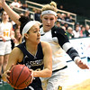 Missouri Southern's Jensen Maydew tries to stop Washburn's Olivia Montague (20) during their game on Wednesday night at Leggett & Platt.<br /> Globe | Laurie Sisk