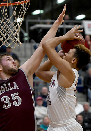 Joplin's Zach Westmoreland (32) drives to the basket as Rolla's Nick Janke (35) defends during their game on Friday night at Kaminsky Gymnasium.<br /> Globe | Laurie Sisk