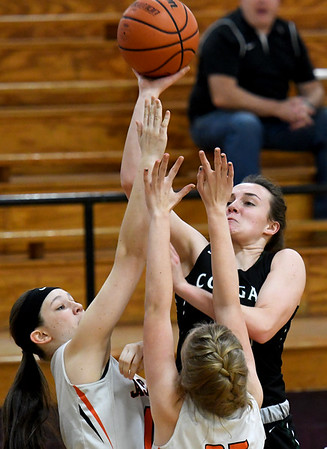 College Heights' Marlee Lett (14) puts up a shot as Jasper's Baylee Jeffries, left and Kristy Holliday defend during the third place  game of the Sarcoxie Girls Tournament on Saturday at Sarcoxie High School.<br /> Globe | Laurie Sisk