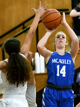 McAuley's Courtney Bates (14) puts up a shot as Sarcoxie's Annette Ramirez defends during the championship game of the Sarcoxie Girls Tournament on Saturday at Sarcoxie High School.<br /> Globe | Laurie Sisk