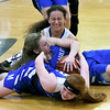 Front to back: McAuley's Dorothy Ostmeyer and Courtney Bates battle Sarcoxie's Annette Ramirez for a loose ball during the championship game of the Sarcoxie Girls Tournament on Saturday at Sarcoxie High School.<br /> Globe | Laurie Sisk