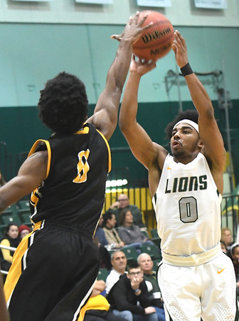 Missouri Southern's CJ Carr puts up a shot as Missouri Western's Bryan Hudson defends during their game on Saturday afternoon at Leggett & Platt.<br /> Globe | Laurie Sisk