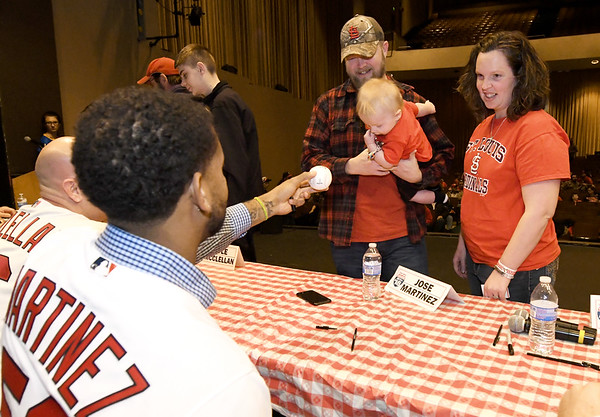 Nine-month-old lifelong Cardinals fan Gunner Neher, of Oronogo, gets a baseball signed by Cardinals first baseman José Martinez during a Cardinals Caravan stop on Saturday at Missouri Southern. Gunner attended his first Cardinals game when he was three weeks old. Joining him are his father, Jeremy Neher and mother, Vanessa Neher.<br /> Globe | Laurie Sisk