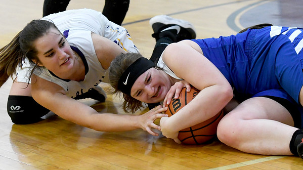 From the left: Sarcoxie's Kierston Dodson and McAuley's Abby Schiefelbein battle for a loose ball during the championship game of the Sarcoxie Girls Tournament on Saturday at Sarcoxie High School.<br /> Globe | Laurie Sisk