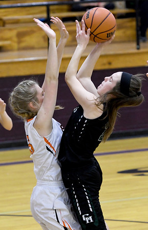 College Heights' Grace Bishop shoots over Jasper's Kristy Holliday during the third place game of the Sarcoxie Girls Tournament on Saturday at Sarcoxie High School.<br /> Globe | Laurie Sisk