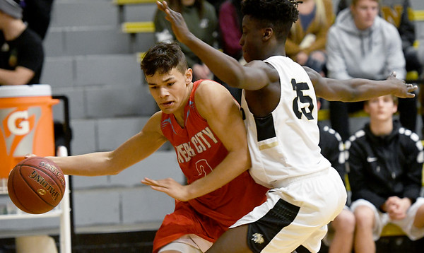 Webb City's Tevaris Young (2) drives the baseline as Neosho's Sam Cook (25) defends during their game on Tuesday night at Neosho.<br /> Globe | Laurie Sisk