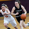 College Heights' Marlee Lett (14) works to get by Jasper's Terra Bowman (13) during the third place  game of the Sarcoxie Girls Tournament on Saturday at Sarcoxie High School.<br /> Globe | Laurie Sisk