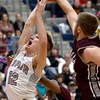 Joplin's Blake Tash (12) gets his shot blocked by Rolla's Nick Janke (35) during their game on Friday night at Kaminsky Gymnasium.<br /> Globe | Laurie Sisk