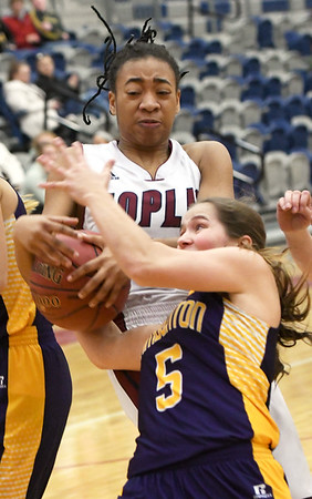 Joplin's Malia Mack (15) battles Camdenton's Shelby Kurtz (5)for a rebound during their game on Friday night at JHS.<br /> Globe | Laurie Sisk