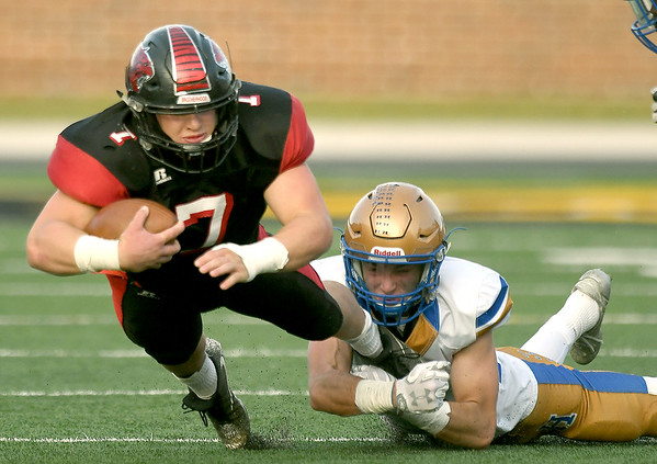 Lamar's Cooper Lucas (7) tries to escape the grasp of Lafayette County's Caleb Russell during their Class 2 Championship game last November at Faurot Field in Columbia.<br /> Globe | Laurie Sisk
