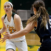 Missouri Southern's Kamiron Luptak (23) looks for an open teammate as Washburn's Alexis McAfee (15) defends during their game on Wednesday night at Leggett & Platt.<br /> Globe | Laurie Sisk