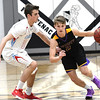 Monett's Gavin Carr (2) tries to get past Webb City's Kyle Nichols (0) during their first-round game of the Kansas Army National Guard Invitational on Thursday night at Frontenac High School.<br /> Globe | Laurie Sisk