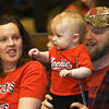 Nine-month-old lifelong Cardinals fan Gunner Neher, of Oronogo, watches players answer questions during a Cardinals Caravan stop on Saturday at Missouri Southern. Gunner attended his first Cardinals game when he was three weeks old. Joining him are his father, Jeremy Neher and mother, Vanessa Neher.<br /> Globe | Laurie Sisk