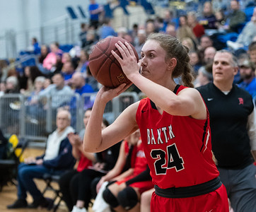 Baxter's Delaney Barnes (24) shoots for three points during the game against Riverton on Friday night at Riverton High School.