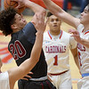 Joplin's Isaiah Davis (20) drives the lane as Webb City's Gary Clinton, left, Terrell Kabala (1) and Alex Gaskill (5) defend during their game on Tuesday night at Webb City High School.<br /> Globe | Laurie Sisk