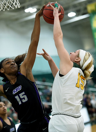Missouri Southern's Chelsey Henry (15) challenges Southwest Baptist's Taliayah (15) during their game on Saturday at Leggett & Platt.<br /> Globe | Laurie Sisk