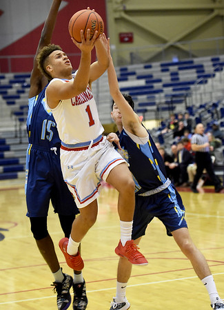 Webb City's Terrell Kabala (1) gets past St. Louis Christian's Ihsancem Yilmaz (15) and Vangelis Dermisis (21) for a score during their first round game in the Kaminsky Classic on Thursday night at JHS.<br /> Globe | Laurie Sisk