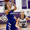 Carthage's Jillian Brunnert (3) finds an open shot as Pittsburg's Zoe Pinamonti (10) looks on during their game in the opening round of the Bill Hanson Memorial Tournament on Wednesday night at Pittsburg High School.<br /> Globe | Laurie Sisk