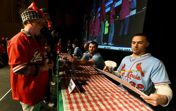 From the left: Eleven-year-old Cardinal fan Evie Meredith gets an autograph from St. Louis pitcher Jack Flaherty during the Cardinals Caravan on Saturday at Missouri Southern.<br /> Globe | Laurie Sisk