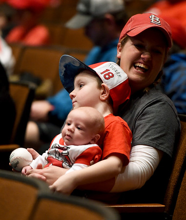 From the left: Two-month-old Ryker Campbell, of Arma, his 4-year-old cousin Lee Snow, of Columbus and Lee's mother Robin Snow don their Cardinals gear as they brave cold temperatures to attend the Cardinals Caravan on Saturday at Missouri Southern.<br /> Globe | Laurie SIsk