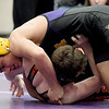 Monett's Joseph Semerad, top, works to pin McDonald County's Jordan Meador diuring their 132-lb. match at the Ozark 8 Wrestling Championships on Friday night at Monett High School.<br /> Globe | Laurie SIsk