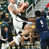 Missouri Southern's Cam Martin (31) draws a foul on Washburn's Javion Blake (5) during their game on Wednesday night at Leggett & Platt.<br /> Globe | Laurie Sisk