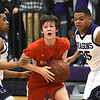 Carl Junction's Isaac Hoberecht, center, tries to split Pittsburg defenders Jayon grant, left and Jerek Butcher (35) during their game in the opening round of the Bill Hanson Memorial Tournament on Wednesday night at Pittsburg High School.<br /> Globe | Laurie Sisk