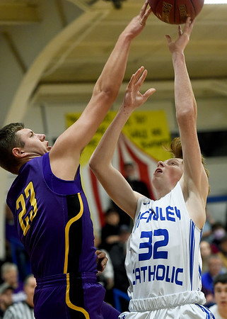 Verona's Caleb Hillhouse (23) gets a block on McAuley's Daniel Wagner (32) during their game on Friday night at McAuley.<br /> Globe | Laurie Sisk