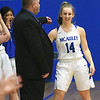 McAuley's Courtney Bates is congratulated by head coach Brandon Weiss after surpassing the 1,000 point mark for her career during the Warriors game against Verona on Friday night at McAuley.<br /> Globe | Laurie Sisk
