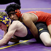 McDonald County's Junior Teriek, top,  battles Monett's Corbin McCully during their 145-lb. match at the Ozark 8 Wrestling Championships on Friday night at Monett High School.<br /> Globe | Laurie SIsk