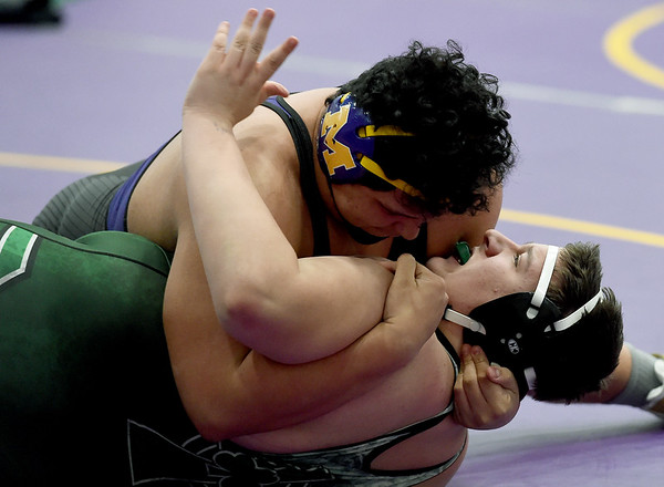 Monett's Ray Villalta, top, works on a pin of Springfield Catholic's Eyan Collins during their 285-lb. match at the Ozark 8 Wrestling Championships on Friday night at Monett High School.<br /> Globe   Laurie SIsk