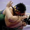 Monett's Ray Villalta, top, works on a pin of Springfield Catholic's Eyan Collins during their 285-lb. match at the Ozark 8 Wrestling Championships on Friday night at Monett High School.<br /> Globe | Laurie SIsk
