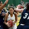 Missouri Southern's Amber Buch drives the lane as Washburn's Hunter Bentley (23) and Hayley Thompson (31) defend during their game on Wednesday night at Leggett & Platt.<br /> Globe | Laurie Sisk