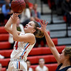 Webb City's Jaydee Duda (14) gets past Joplin's Madeleine Farber for a score during their game on Tuesday night at Webb City High School.<br /> Globe | Laurie Sisk