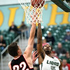 Missouri Southern's Braelon Walker (5) and Central Missouri's Matt Wilkinson (22) vie for a rebound during their game on Thursday night at Leggett & Platt.<br /> Globe | Laurie Sisk