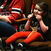 Isabella Henning, 2, of Carl Junction, enjoys a snack as she waits paitently for the arrival of the Cardinals Caravan on Saturday at Missouri Southern.<br /> Globe | Laurie Sisk