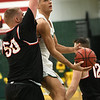 Missouri Southern's Kinzer Lambert (11) drives to the basket as Central Missouri's Jakob Lowrance (50) defends during their game on Thursday night at Leggett & Platt.<br /> Globe | Laurie Sisk