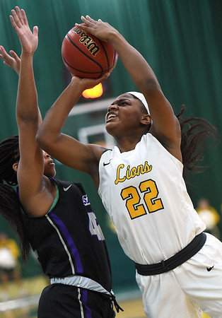 Missouri Southern's Chasidee Owens (22) drives and scores on Southwest Baptist's Sydney Bandy (42) during their game on Saturday at Leggett & Platt.<br /> Globe | Laurie Sisk