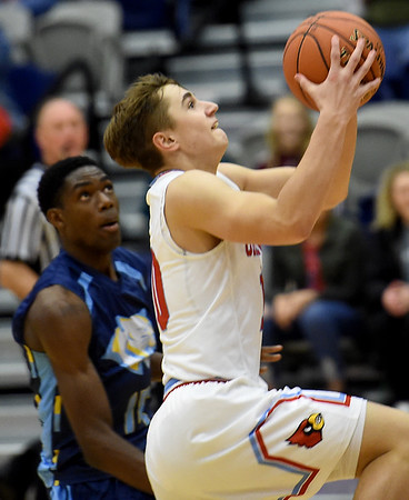 Webb City's Gary Clinton (10) gets past St. Louis Christian's Ihsancem Yilmaz (15) for a score during their first round game in the Kaminsky Classic on Thursday night at JHS.<br /> Globe | Laurie Sisk