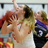 Pittsburg State'sMegan Scott (42) scores as Southwest Baptist's Caylee Richardson (3) defends during their game on Wednesday night at John Lance Arena.<br /> Globe | Laurie Sisk