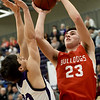Pittsburg's Payton Cantrell (20) challenges a shot by Carl Junction's Alex Baker (23) during their game in the opening round of the Bill Hanson Memorial Tournament on Wednesday night at Pittsburg High School.<br /> Globe | Laurie Sisk