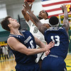 Missouri Southern's Braelon Walker (5) scores over Washburn's David Salach (40) and Tyas Martin (13) during their game on Wednesday night at Leggett & Platt.<br /> Globe | Laurie Sisk
