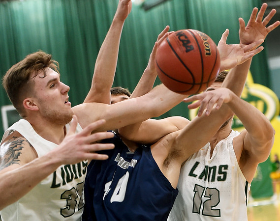 Missouri Southern's Cam Martin (31) and Enis Memic (12) battle Washburn's David Salach (40) for a rebound during their game on Wednesday night at Leggett & Platt.<br /> Globe | Laurie Sisk